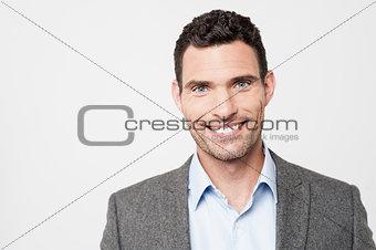 Smiling businessman posing to camera