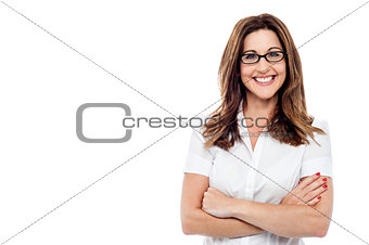 Corporate woman with folded arms