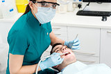 Dentist examining mouth of patient