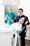 Dentist ready to examine the patient