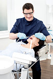 Dentist examine on a female patient