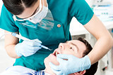 Professional dentist doing teeth checkup