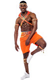 Male samba dancer posing on one leg
