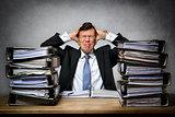 Overworked stressed businessman