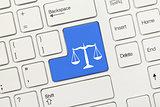 White conceptual keyboard - Law symbol (blue key)
