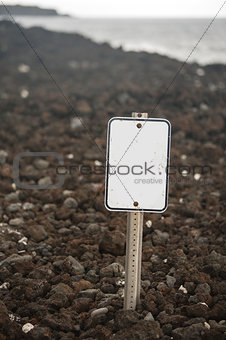 Blank Sign on Rock Beach