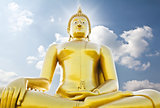 Big golden buddha statue against sky