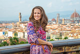Happy young woman against panoramic view of florence, italy
