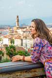 Young woman against panoramic view of florence, italy