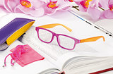 reading glasses endorsed on a book at home