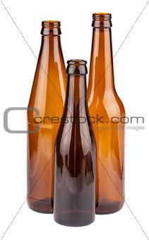 Three empty brown bottles