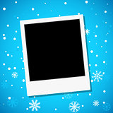 Photo frame on a snowy background