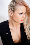 beautiful blonde young sexy woman thinking serious