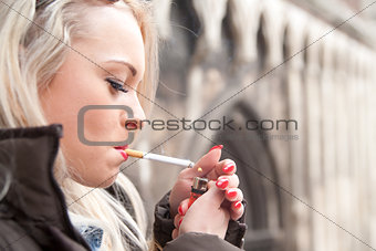 tourist lighting up a a cigarette in an European city