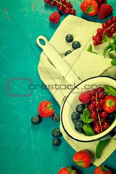 Fresh Berries on Wooden Background. Strawberries, Raspberries an