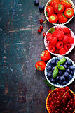 Fresh Berries on Wooden Background. Strawberries, Raspberries an