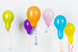 Balloons of different bright colors on a white background