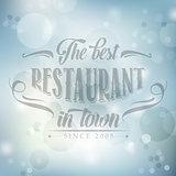retro restaurant poster on blue blurred background