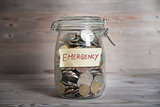 Money jar with emergency label.