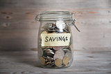 Money jar with savings label.