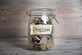 Money jar with pension label.