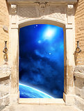 Ancient door and space scene