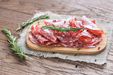 Slices of salami on the wooden board