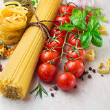 Pasta spaghetti, cherry tomatoes and spices, ingredients