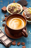 Coffee with chocolate and cupcake