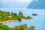 sailing yacht in the beautiful sea bay in the mountains