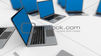 3d render of a lot of laptops in a row.