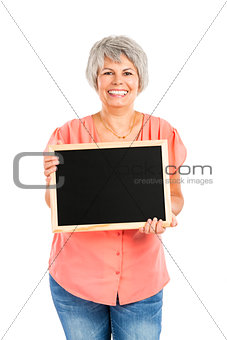 Old woman holding a chalkboard