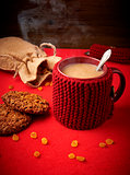 Mug of coffee with cookies