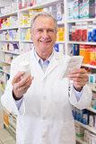 Senior holding medicine box and prescription