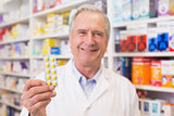 Senior pharmacist holding blister packs