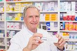 Pharmacist showing medicine box