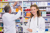 Pharmacists searching medicines with prescription