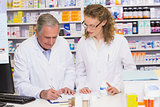 Team of pharmacist looking a medication for a prescription