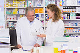 Team of pharmacists looking at prescription