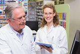 Team of pharmacists using laptop pc