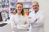 Smiling pharmacists with arms crossed
