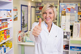 Pharmacist holding her thumb up