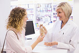 Pharmacist giving medicine to costumer