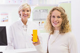 Smiling costumer with a medicine bottle