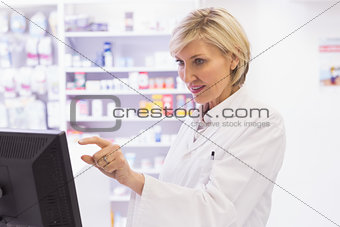 Focused pharmacist using the computer