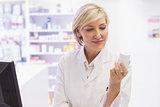 Pharmacist holding medicine jar