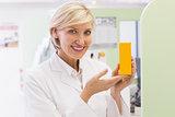 Pharmacist showing medicine jar