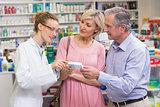 Pharmacist explaining the drug to costumers