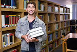 Student smiling at camera in library