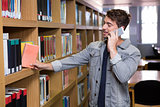 Student talking on the phone in library